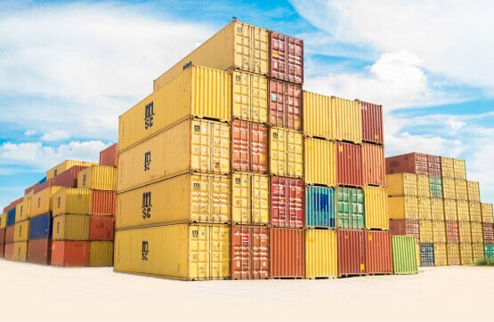 Stack of yellow red green and blue crates at a shipping yard